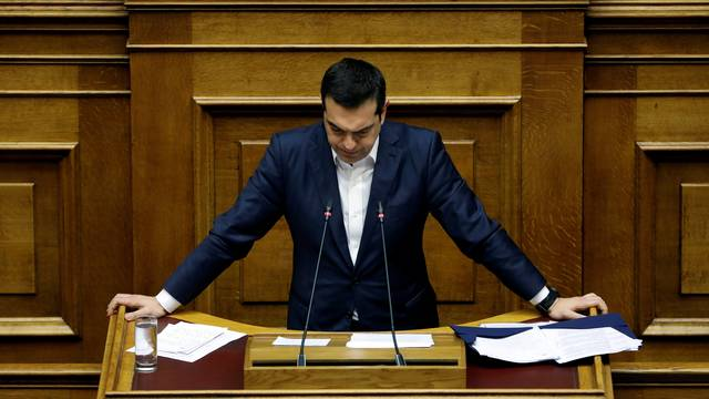 Greek PM Tsipras pauses as he addresses lawmakers during a parliamentary session before a confidence vote in Athens