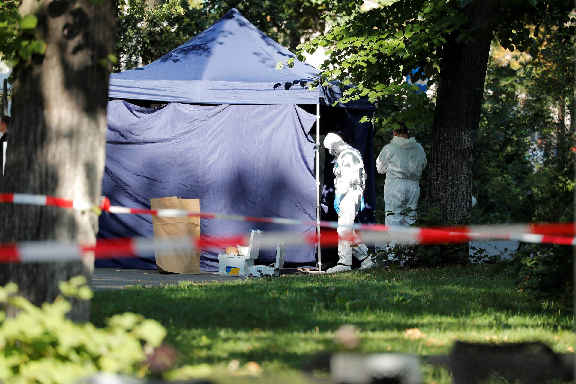 FILE PHOTO: Police officers investigate a crime scene in Berlin
