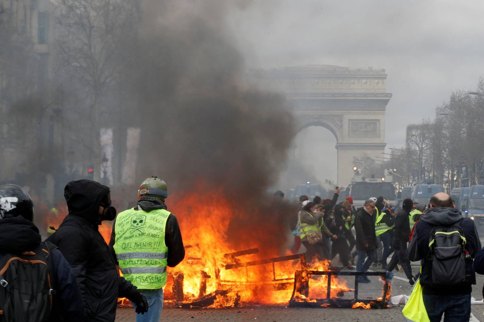 """A burning barricade is seen during a demonstration by the """"yellow vests"""" movement in Paris"""
