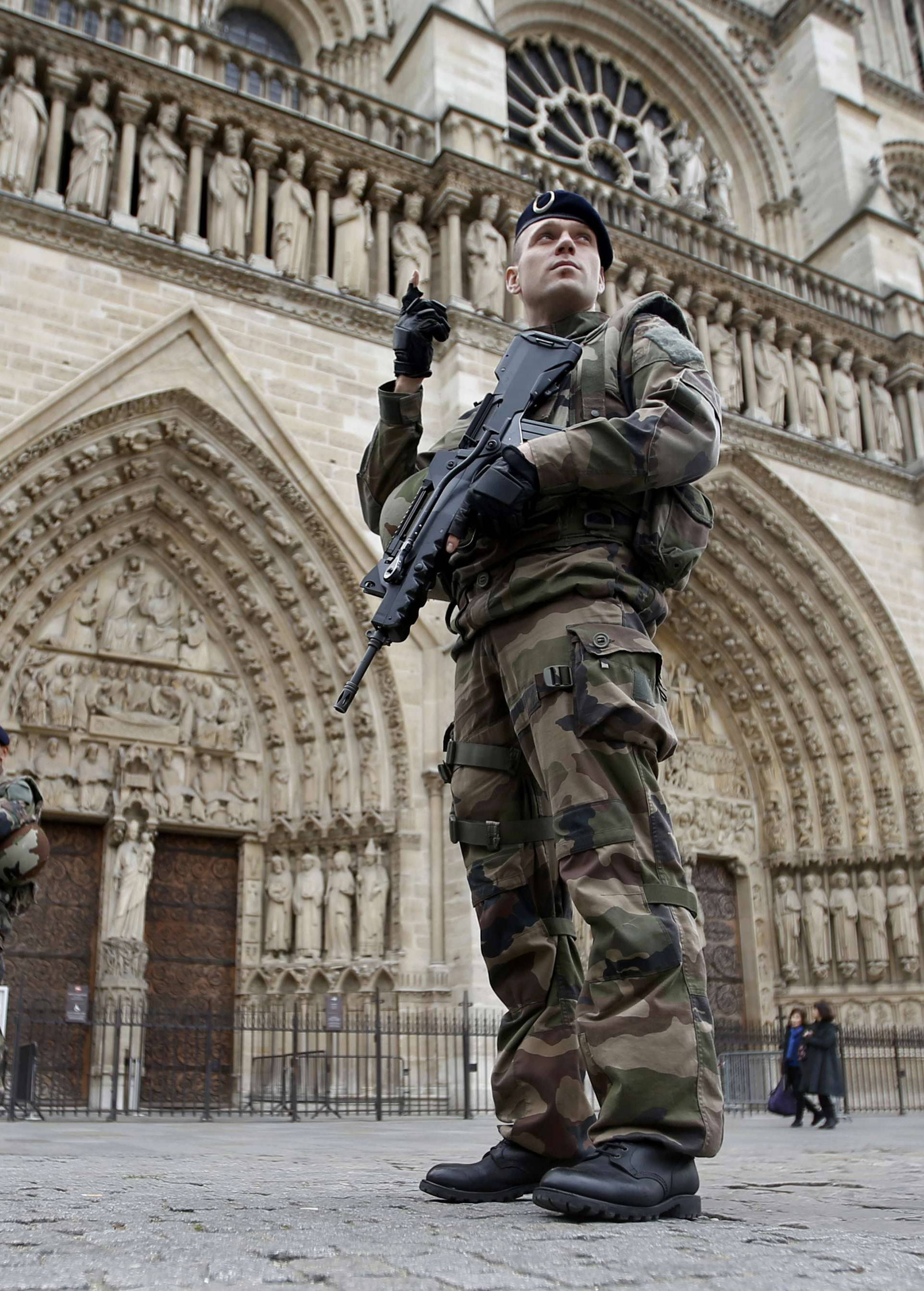 Soldiers patrol in front of the Notre Dame Cathedral in Paris
