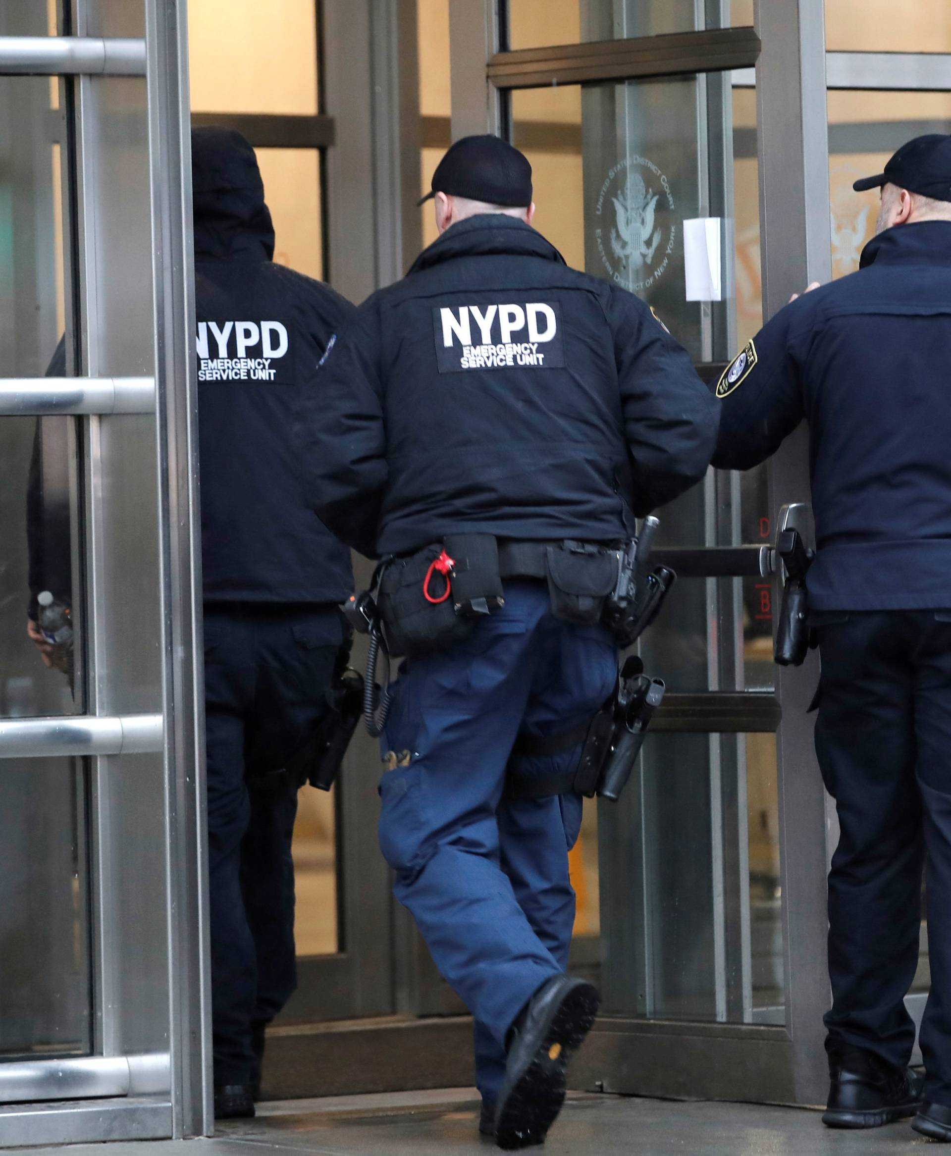 """Police enter the Brooklyn Federal Courthouse ahead of start of the trial of Joaquin Guzman, the Mexican drug lord known as """"El Chapo,"""" in New York"""