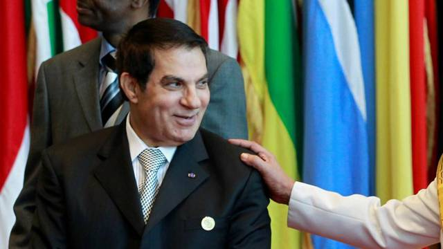 FILE PHOTO: Tunisia's President Ben Ali meets Libya's leader Muammar Gaddafi during an EU-Africa summit in Tripoli