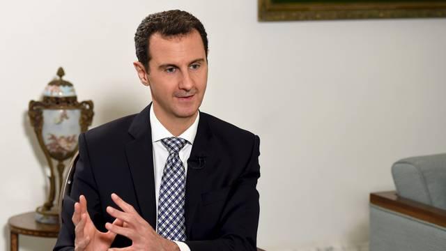 Asad SAD-u: Učite iz iračkog iskustva i napustite Siriju