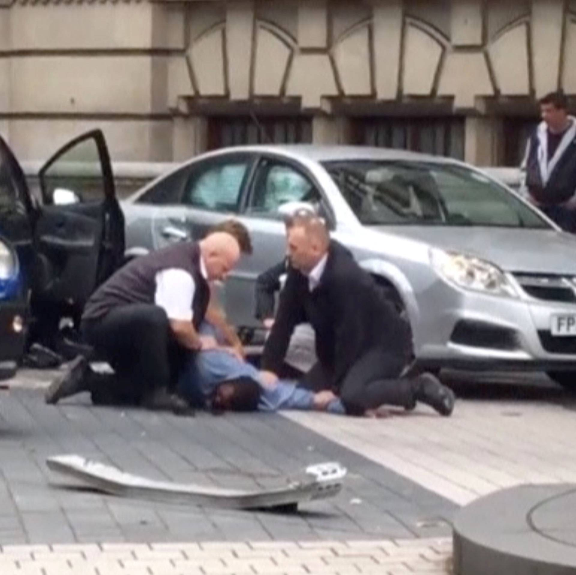 A man is being arrested by police near the Natural History Museum, in London, Britain, in this still image from a video