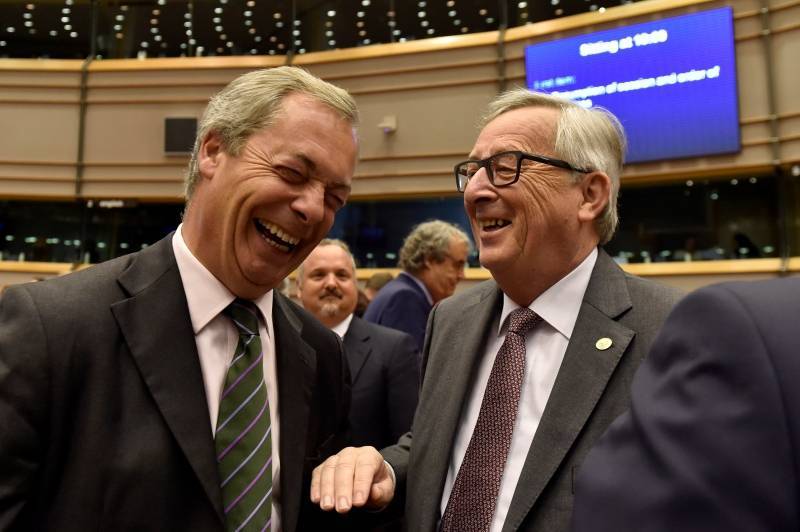 "EC President Juncker welcomes Farage, the leader of the UKIP, prior to a plenary session at the European Parliament on the outcome of the ""Brexit"" in Brussels"