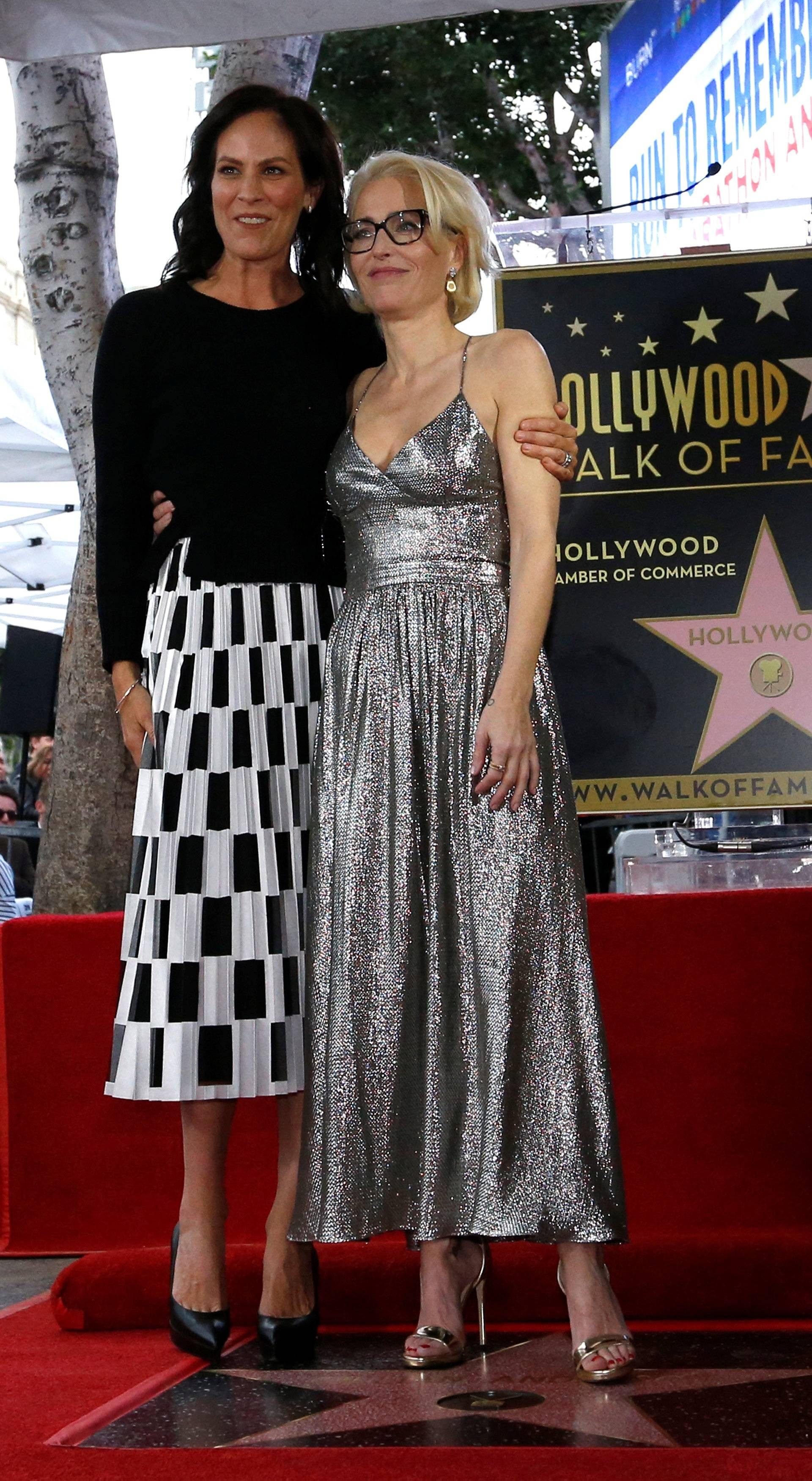 Actor Anderson poses with actor Gish on her star after it was unveiled on the Hollywood Walk of Fame in Los Angeles