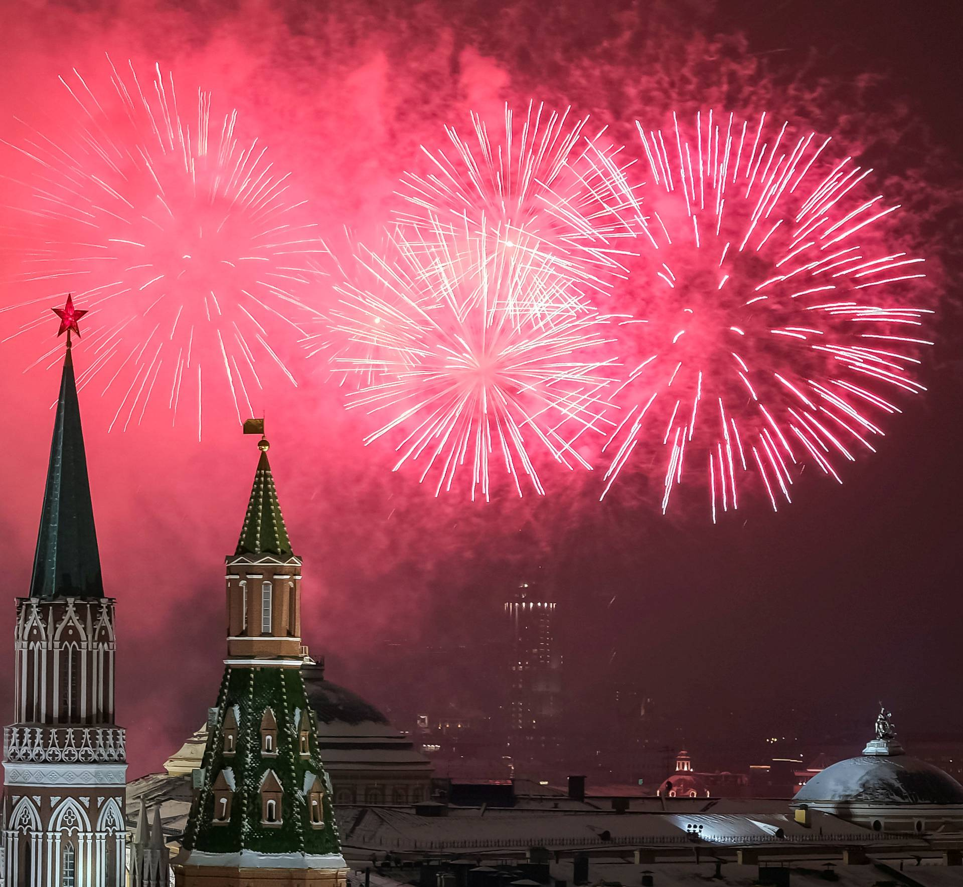 Fireworks explode in the sky over the Kremlin during New Year celebrations in Moscow
