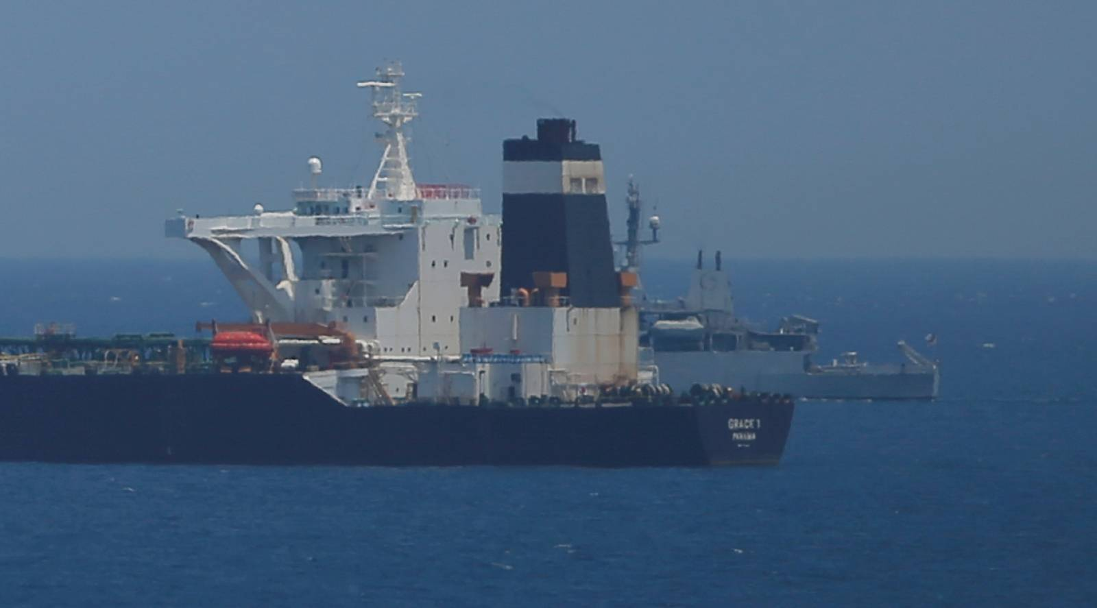 FILE PHOTO: Oil supertanker Grace 1 sits anchored in waters of the British overseas territory of Gibraltar