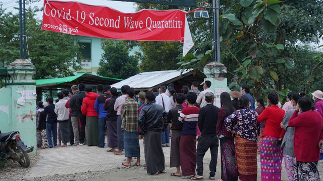 Poeple wait in line before voting during the general election at a polling station in Kachin State, Myanmar