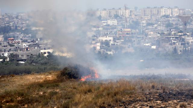 A fire burns in scrubland in Israel near the Gaza Strip, in an area where Palestinians have been causing blazes by flying kites and balloons loaded with flammable material across the border