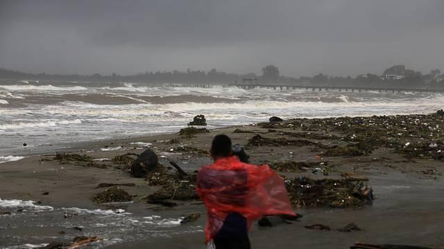 A cameraman films a beach as Hurricane Eta approaches, in Tela