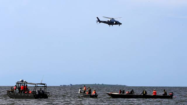 Rescue and recovery missions search for the bodies of dead passengers after a cruise boat capsized in Lake Victoria off Mukono district