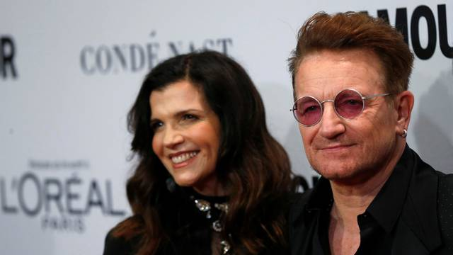 Recording artist and honoree Bono of U2 and his wife Ali Hewson pose at the Glamour Women of the Year Awards in Los Angeles