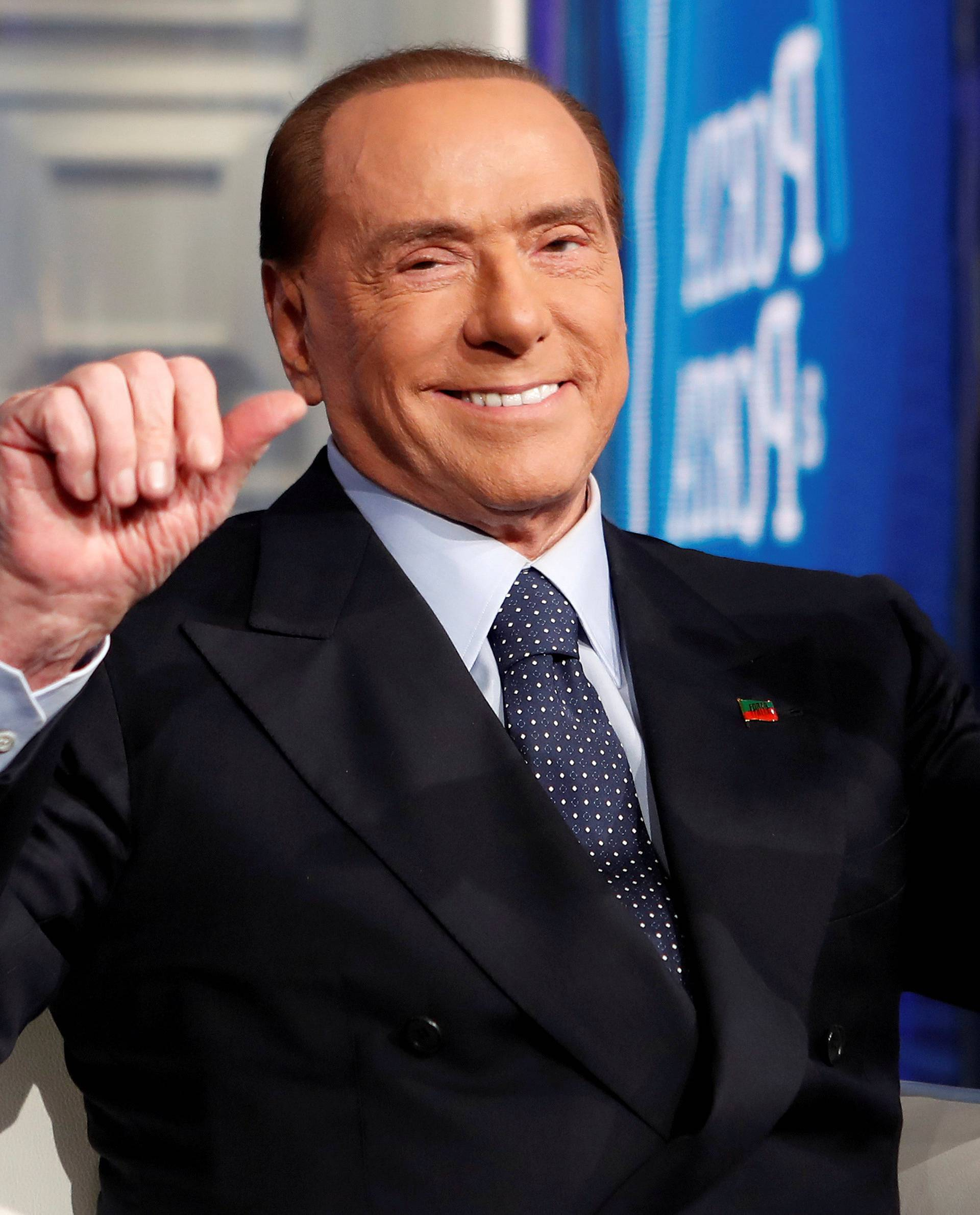 """FILE PHOTO: Italy's former Prime Minister Silvio Berlusconi gestures during the taping of the television talk show """"Porta a Porta"""" (Door to Door) in Rome"""