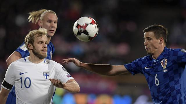 Teemu Pukki of Finland and Vida Domagoj and Matej Mitrovic of Croatia fight for the ball during the FIFA World Cup 2018 football qualification match between Finland and Croatia in Tampere