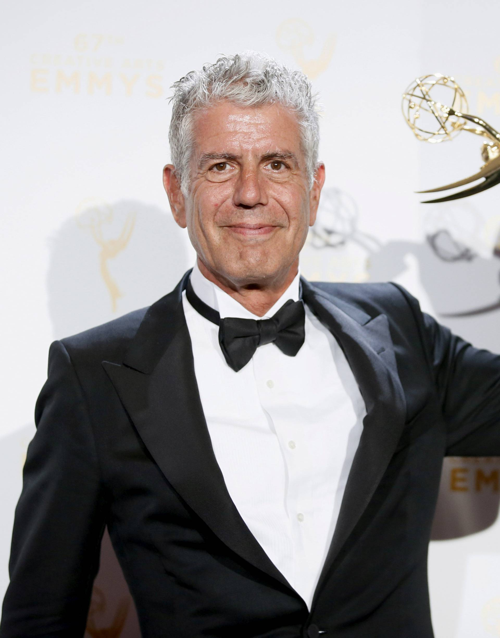"FILE PHOTO: Anthony Bourdain poses with the outstanding informational series or special award for ""Anthony Bourdain Parts Unknown"" backstage at the 2015 Creative Arts Emmy Awards in Los Angeles"