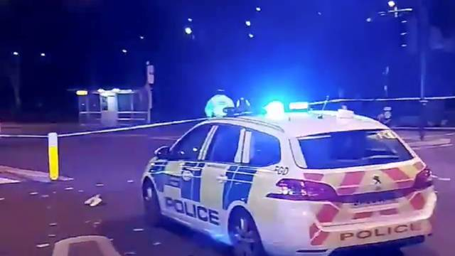 A police car is seen after an incident at Edmonton Police station in London