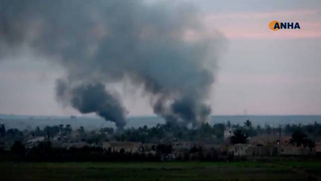 Smoke rises from a village near Baghouz