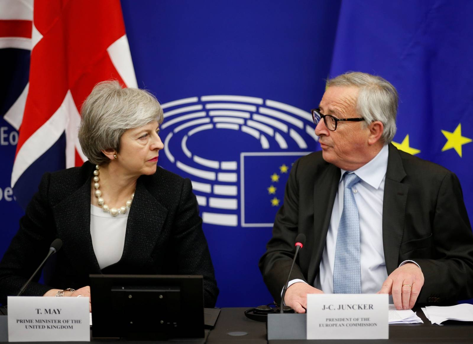 British Prime Minister Theresa May and European Commission President Jean-Claude Juncker look at each other during a news conference in Strasbourg
