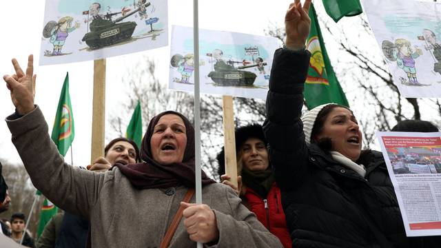 Pro-Kurdish protesters attend a demonstration outside the Turkish Embassy in Berlin