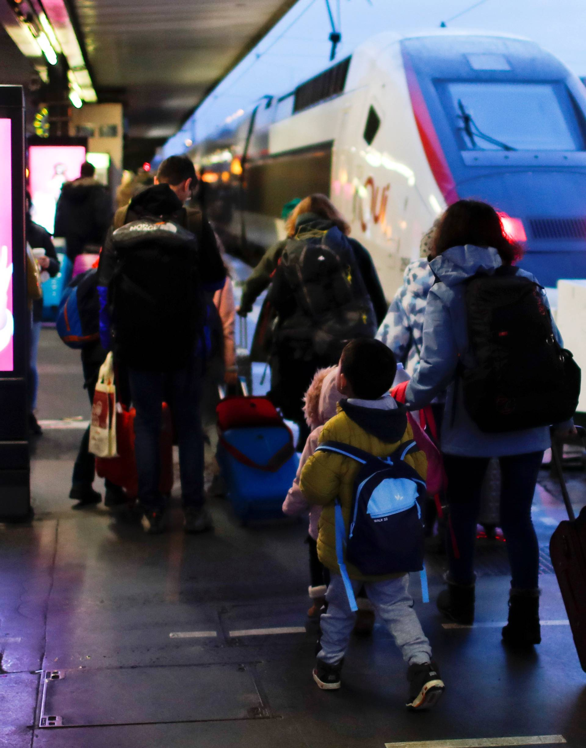 "Minors traveling with service for unaccompanied children ""Junior et compagnie"" walk at Gare de Lyon train station in Paris"