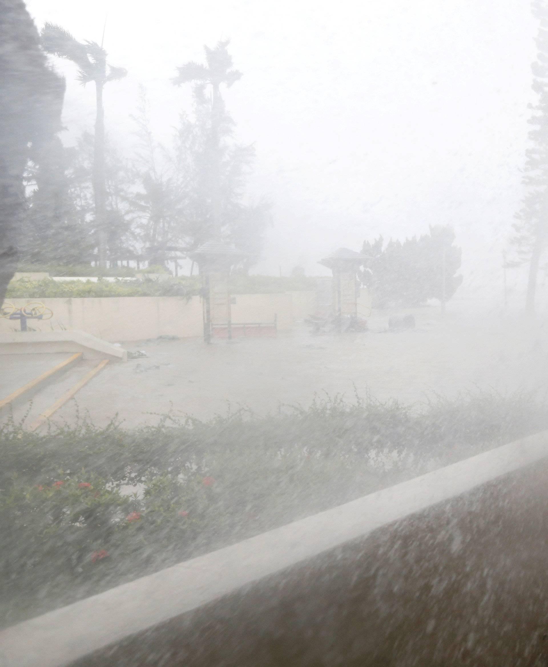 A journalist braves high waves under Typhoon Mangkhut attack in Hong Kong