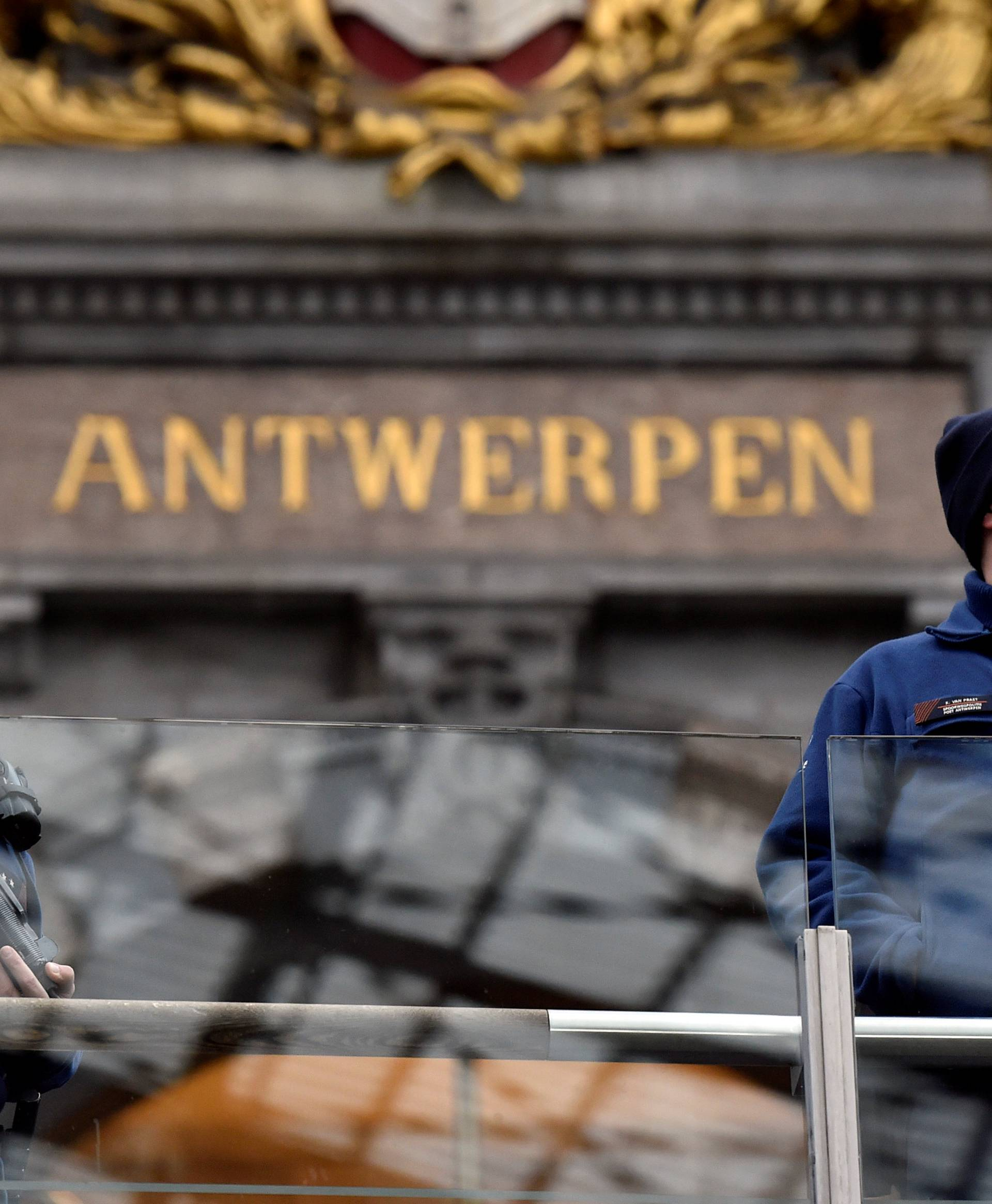 Belgian police officers patrol in the central station, in Antwerp