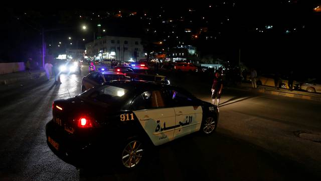 Jordanian police cars are seen one day after the security incident at the city of Al Salt