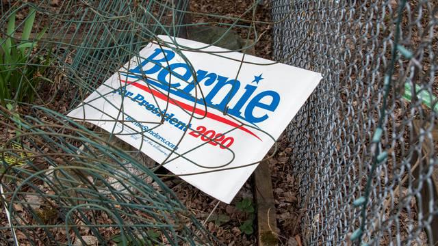 A lawn sign for Democratic 2020 presidential candidate Senator Bernie Sanders lies in a house yard in Burlington