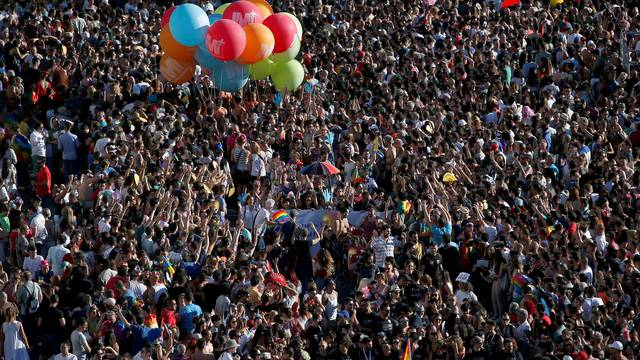 Revellers attend the World Pride parade in Madrid
