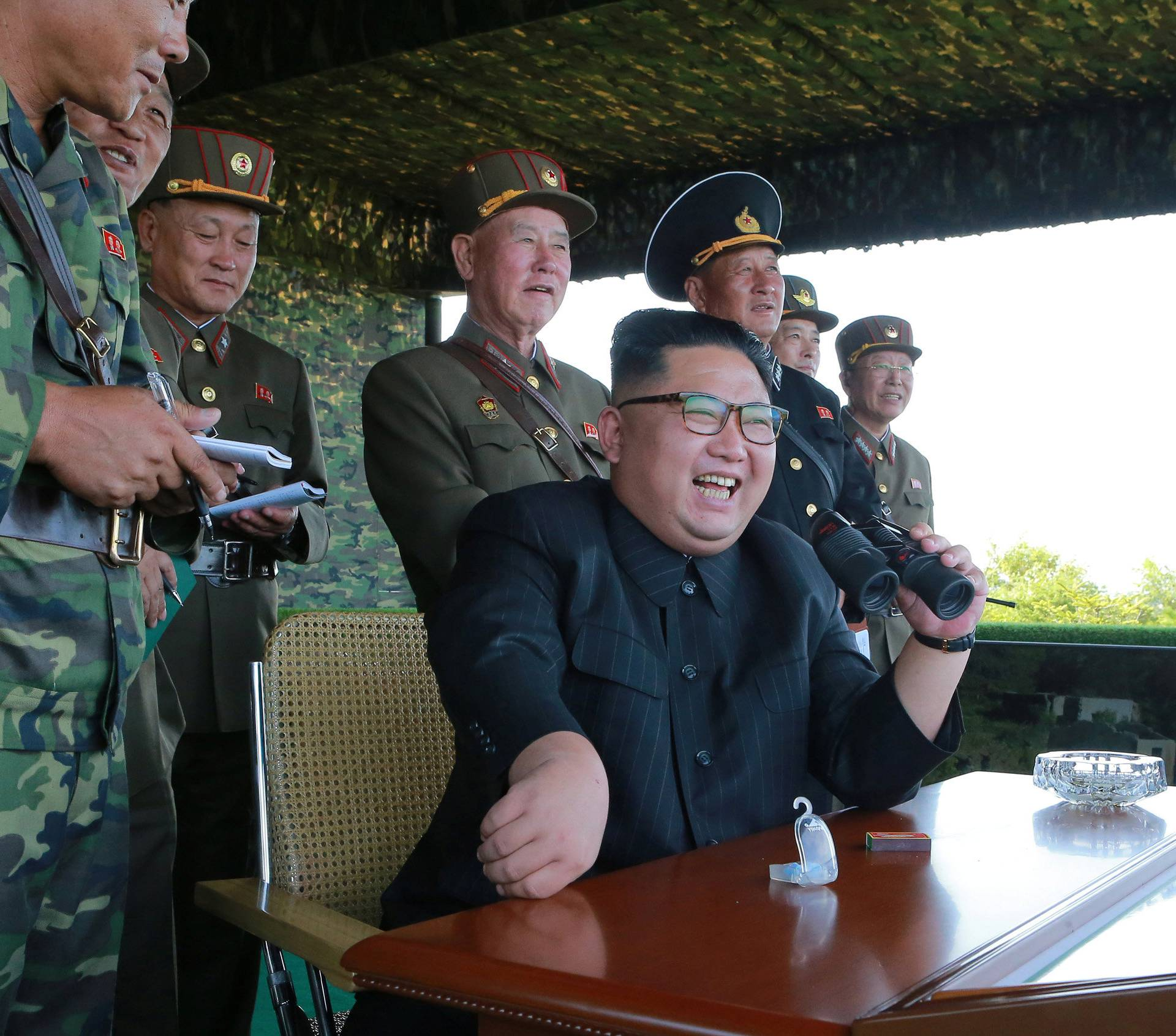 North Korean leader Kim Jong Un guides a target-striking contest of the special operation forces of the Korean People's Army (KPA) to occupy islands