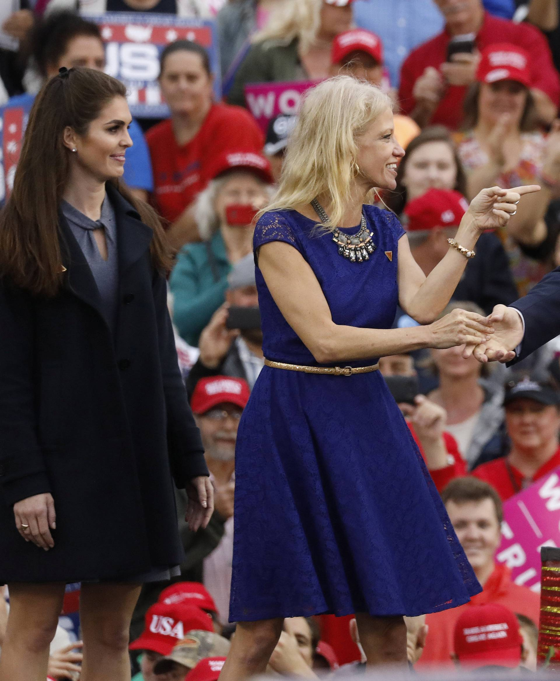 U.S. President-elect Donald Trump greets campaign manager and senior advisor, Kellyanne Conway, and Campaign Communications Director Hope Hicks during a USA Thank You Tour event in Mobile, Alabama