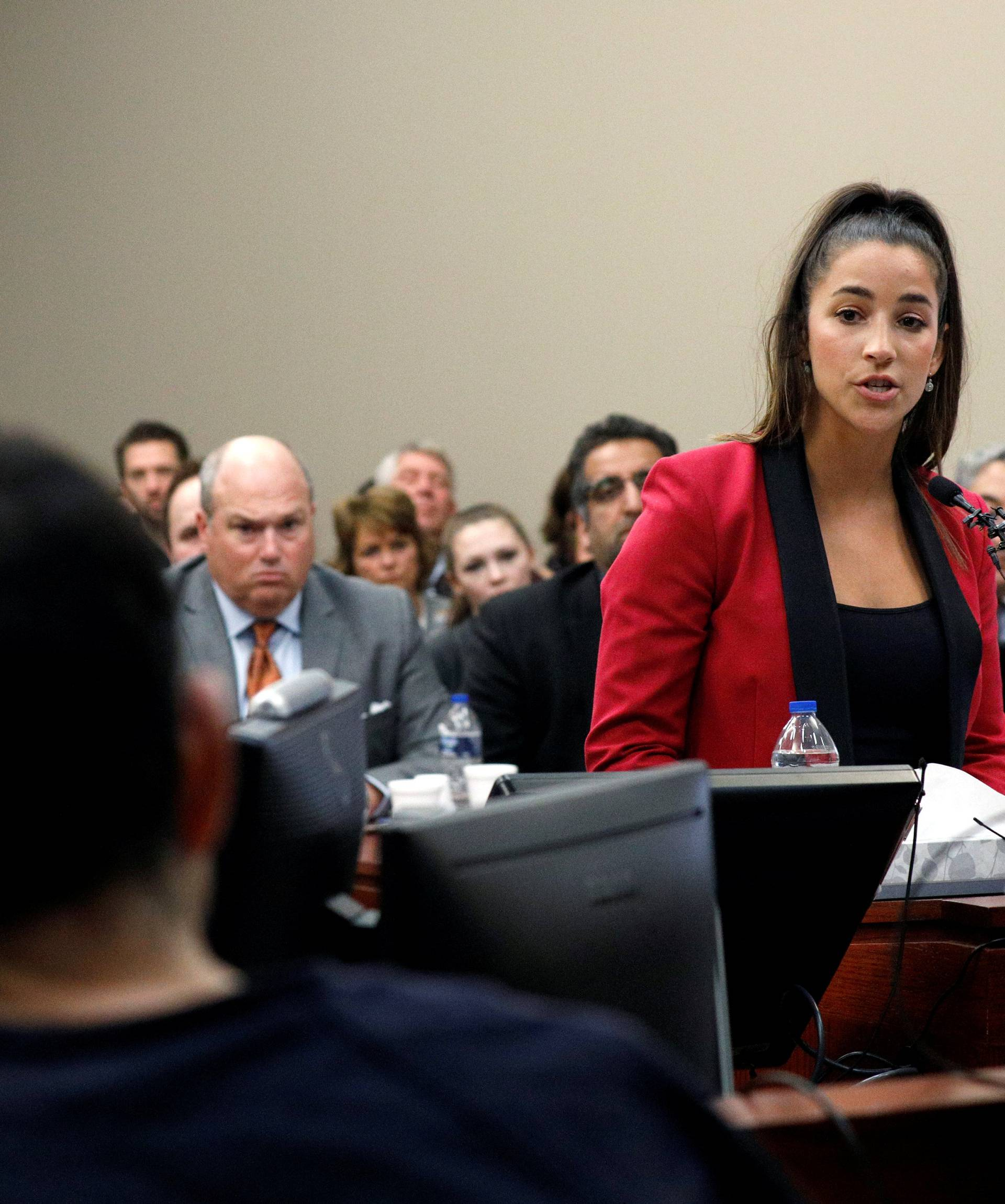 Victim and Olympic gold medalist Aly Raisman speaks at the sentencing hearing for Larry Nassar, a former team USA Gymnastics doctor who pleaded guilty in November 2017 to sexual assault charges, in Lansing