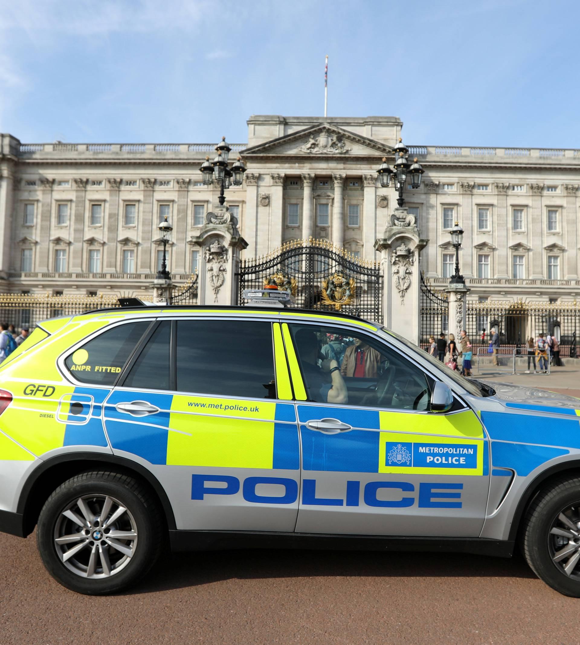 A police vehicle patrols outside Buckingham Palace in London