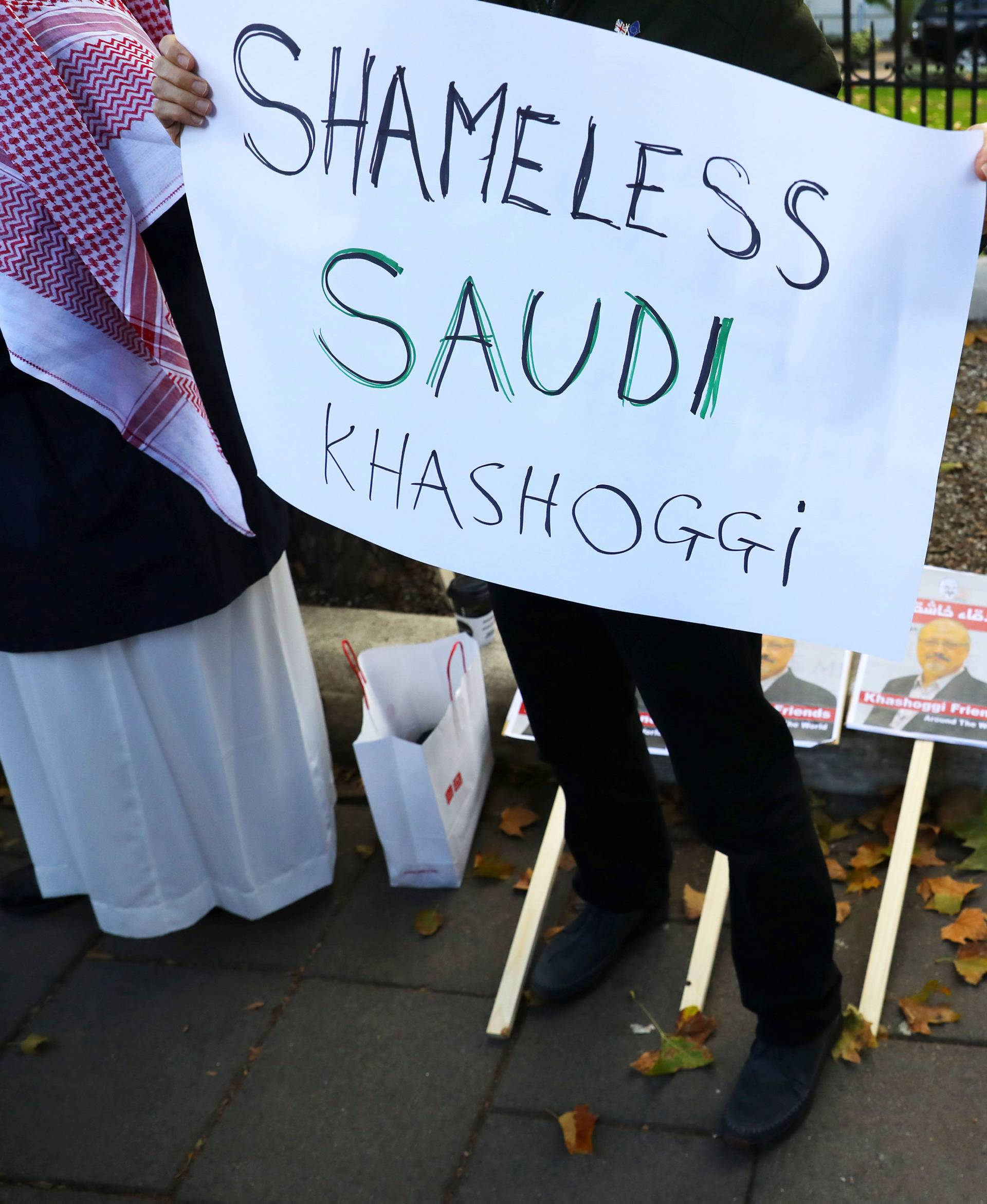 Placards can be seen outside the embassy as people protest against the killing of journalist Jamal Khashoggi in Turkey outside the Saudi Arabian Embassy in London