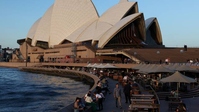 Diners enjoy the harbour waterfront by the Sydney Opera House in Sydney