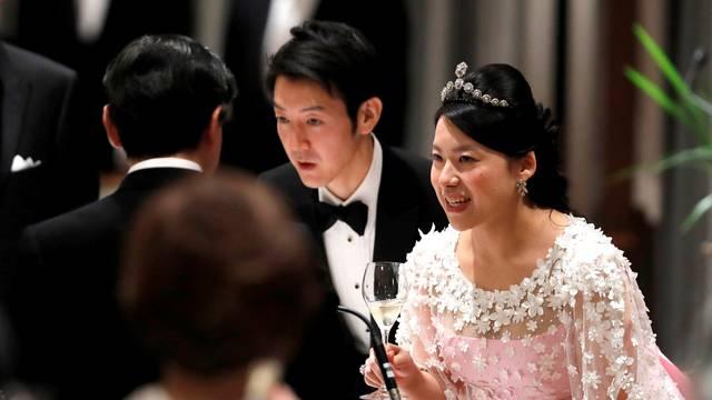 Japan's former princess Ayako Moriya and her husband Kei Moriya toast with Crown Prince Naruhito at their wedding banquet in Tokyo
