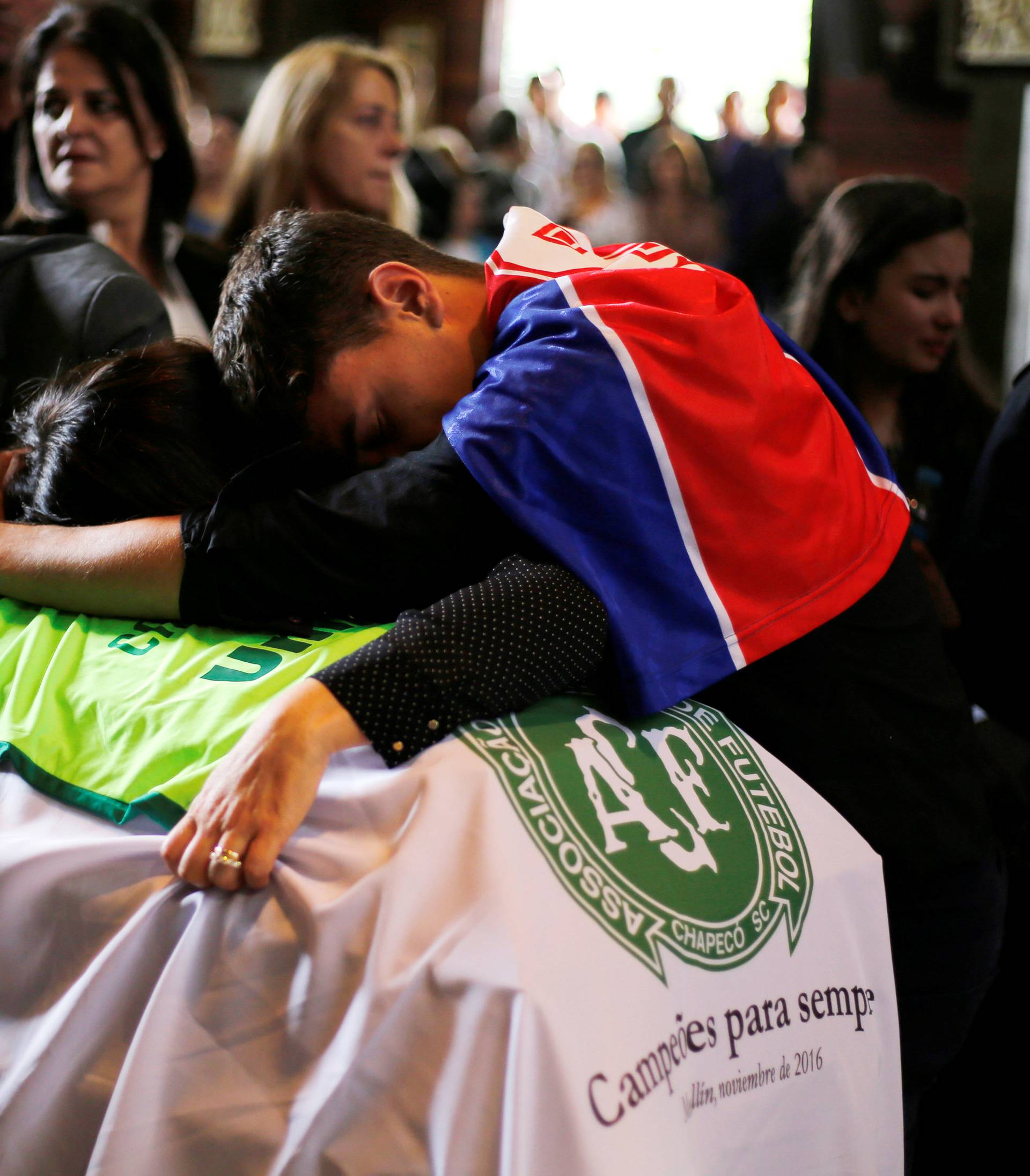 Relatives of Chapecoense soccer club head coach Caio Junior, who died in the plane crash in Colombia, participate in a ceremony to pay tribute to him in Curitiba