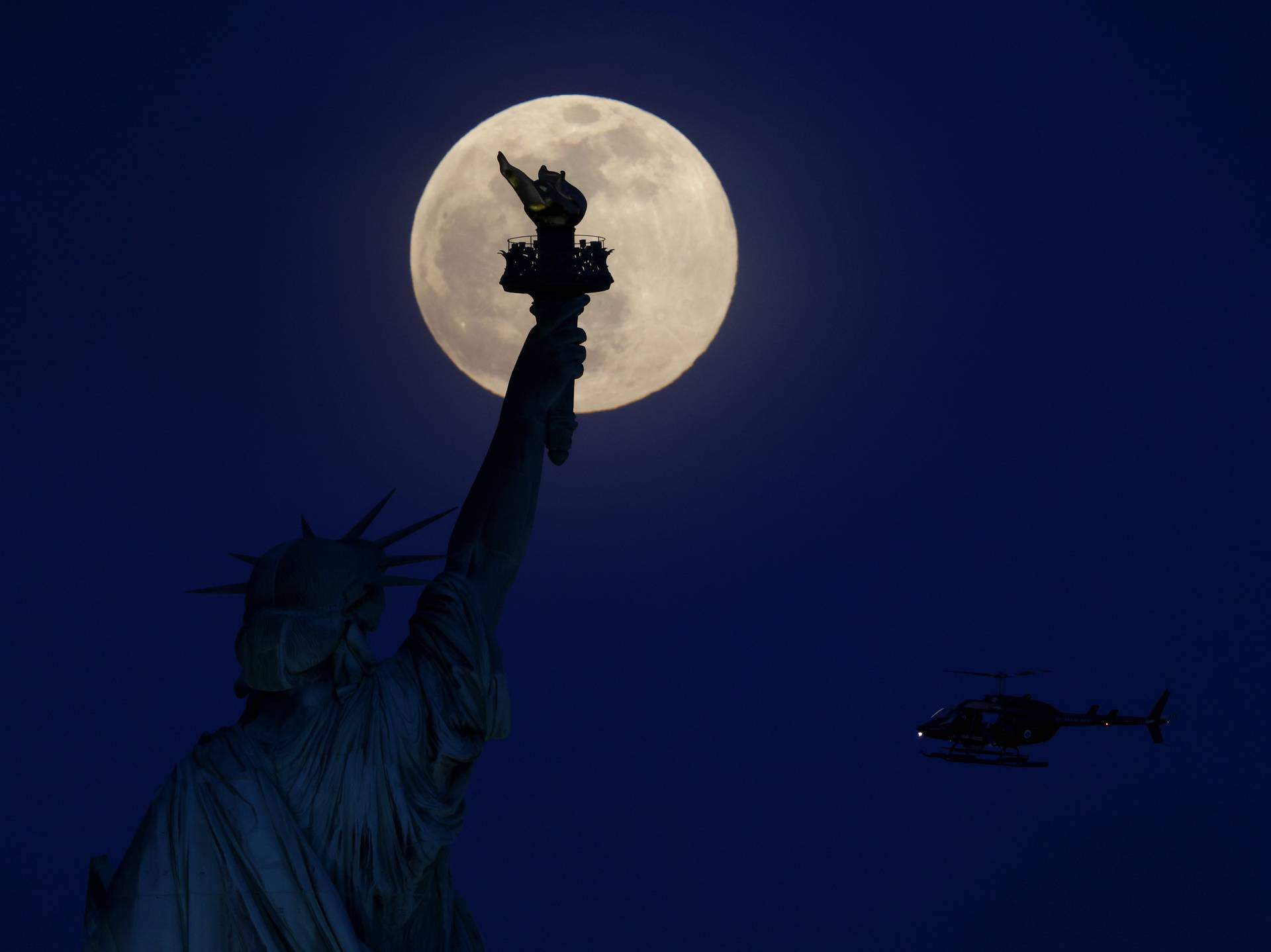 Pink Supermoon Over the Statue Of Liberty in New York