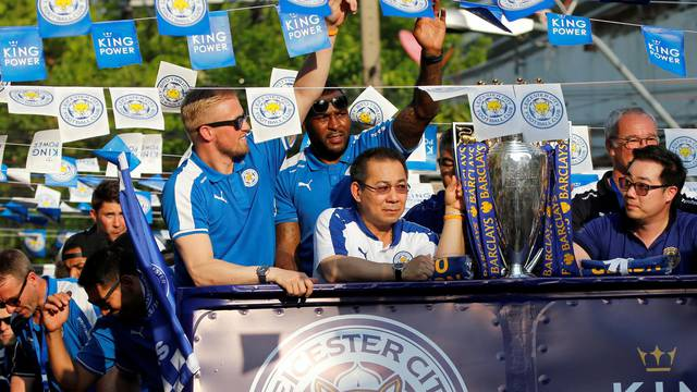Leicester City soccer club's goalkeeper Schmeichel, captain Morgan and owner Vichai Srivaddhanaprabha are seen during a parade to celebrate club's English Premier League title in Bangkok