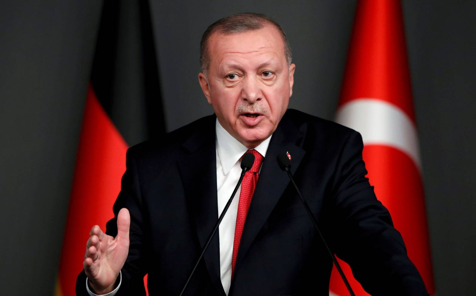 FILE PHOTO: Turkish President Tayyip Erdogan speaks during a news conference in Istanbul
