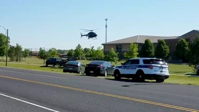 A helicopter lands near Noblesville West Middle School in Noblesville, Indiana