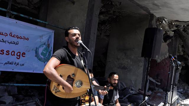 Palestinian singer performs during a musical event calling to boycott the Eurovision Song Contest hosted by Israel, in Gaza City