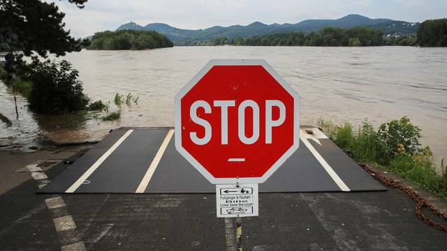 A Stop sign is pictured near a flooded area following heavy rainfalls in Rolandseck