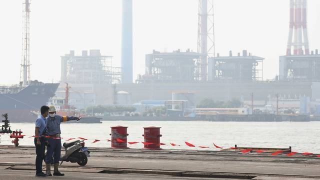 A staff member guards the site of the ceremony for the start of construction of a new submarine fleet in Kaohsiung