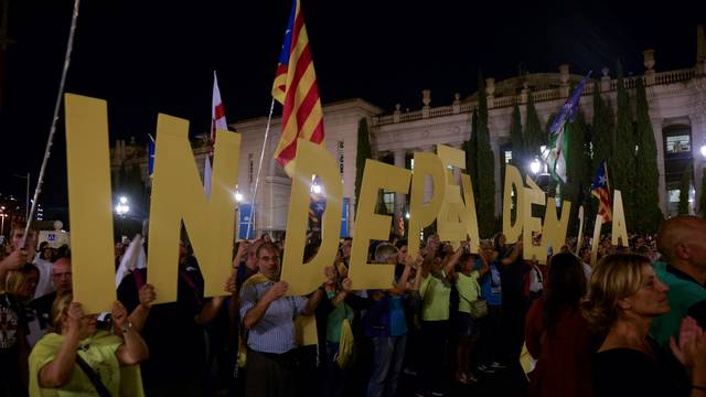 """People hold letters to form the word """"Independence"""" during a closing rally in favour of the banned October 1 independence referendum in Barcelona"""
