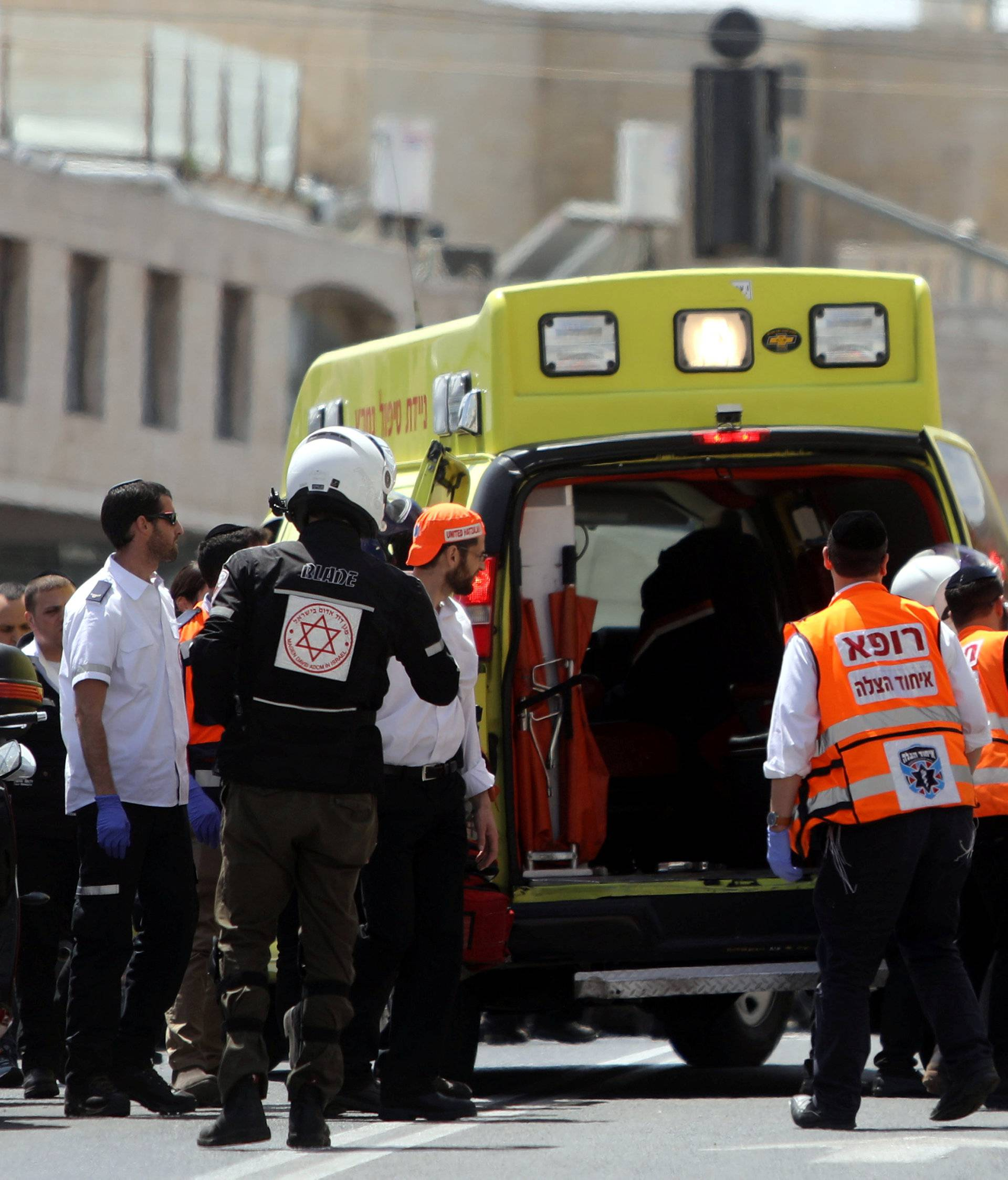 Israeli medics evacuate an injured person following a stabbing attack just outside Jerusalem's Old City, according to Israeli police