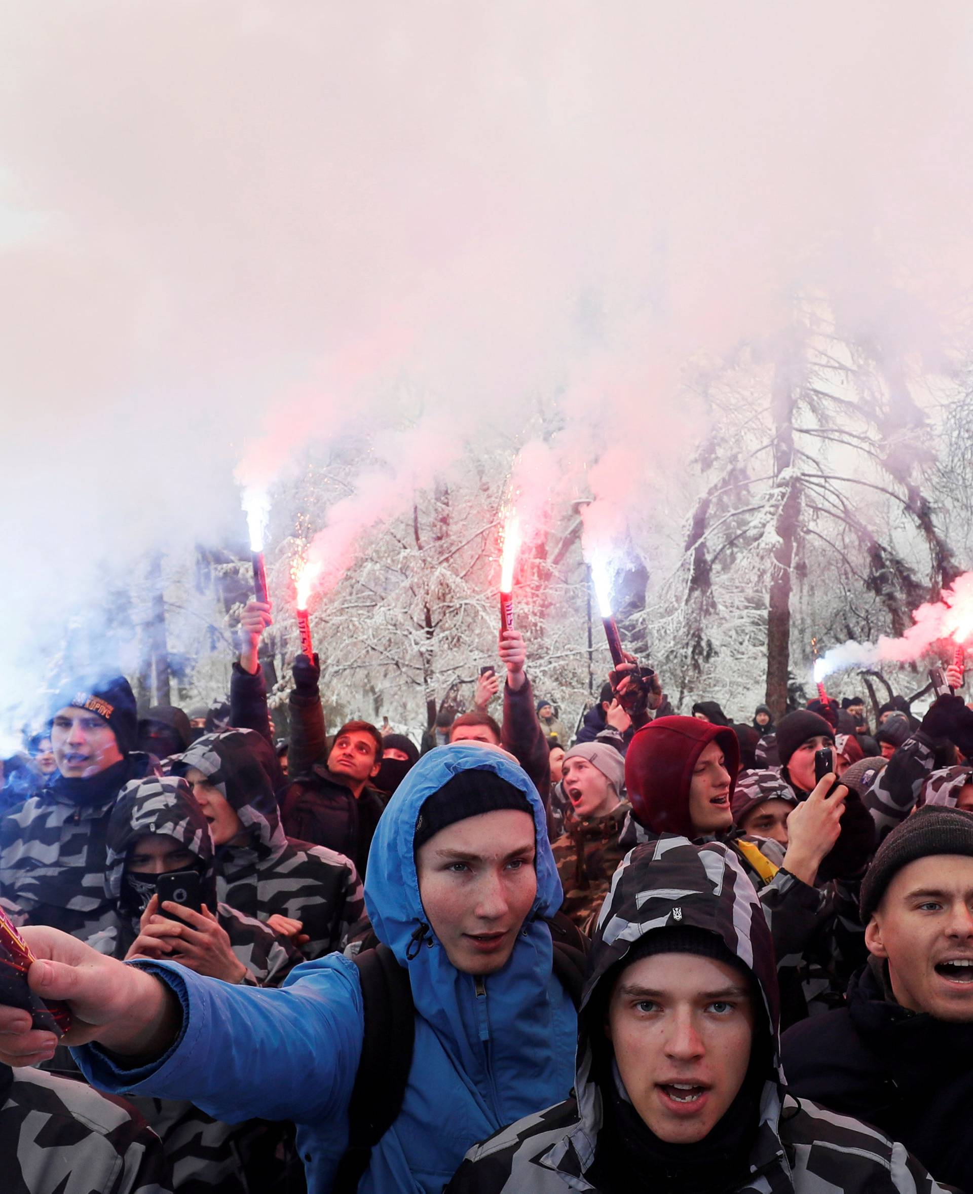 Activists of far-right parties burn flares during a rally to support the Ukrainian navy after Russia seized two Ukrainian armored artillery vessels and a tug boat in the Black Sea, in front of the presidential administration headquarters in Kiev