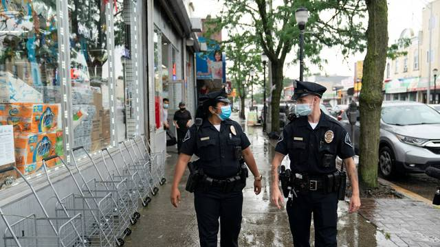 Camden County Police officers Natalie Perez and Alexander Baldwin patrol on the streets of Camden, New Jersey