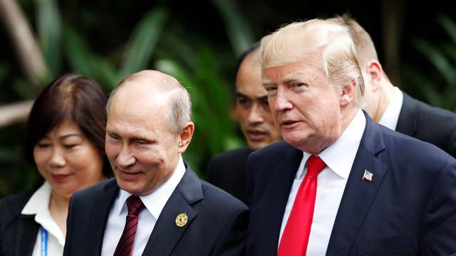 U.S. President Donald Trump and Russia's President Vladimir Putin attend the family photo session at the APEC Summit in Danang, Vietnam